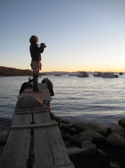 Monica shooting at sunset on the shore of Lake Titicaca in Copa