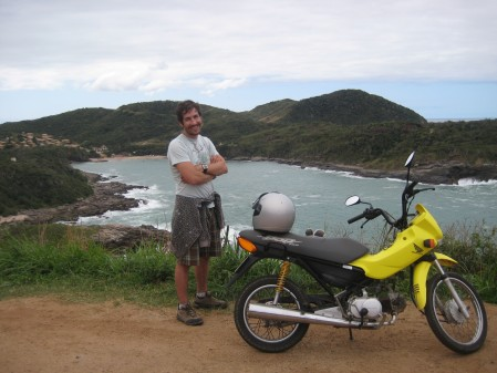 with Maria (the 100 cc Honda) and Praia Brava in the background