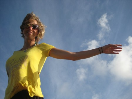 Monica flying above the wall around the Cristo statue in Salvador